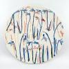 Klokkenrij (2021) (onder)glazuur op aardewerk, doorsnede 29 cm
